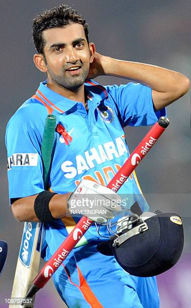 Indian cricketer Gautam Gambhir celebrates his team victory after the second oneday international cricket match between India and New Zealand at The...