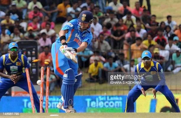 Indian cricketer Gautam Gambhir is bowled by Sri Lankan cricketer Nuwan Kulasekara during the opening oneday international match between Sri Lanka...