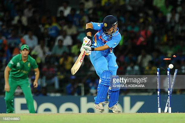 Indian cricketer Gautam Gambhir is bowled out by South Africa cricketer Morne Morkel during the ICC Twenty20 Cricket World Cup's Super Eight match...