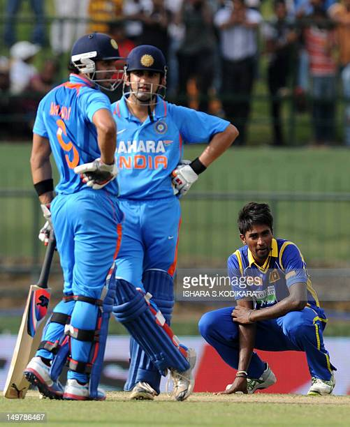 Indian cricketer Gautam Gambhir Manoj Tiwary and Sri Lankan cricketer Nuwan Pradeep look on during the fifth and final oneday international match...