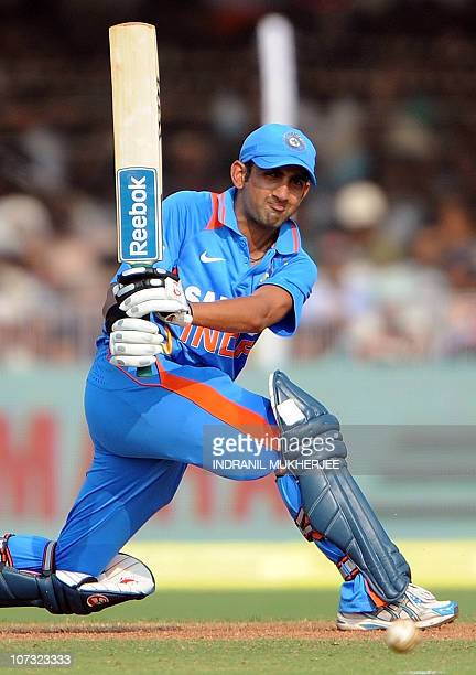 Indian cricketer Gautam Gambhir plays a shot during the third One Day International match between India and New Zealand at the Reliance stadium in...