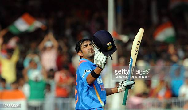 Indian cricketer Gautam Gambhir reacts after reaching a century during the third One Day International match between India and New Zealand at the...