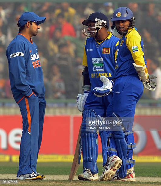 Indian cricketer Gautam Gambhir speaks with Sri Lankan batsmen Sanath Jayasuriya and Thilan Thushara during the fifth and final One Day International...