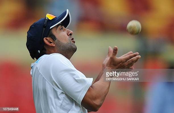 Indian cricketer Gautam Gambhir takes a catch during a training session ahead of the fourth One Day International match between India and New Zealand...