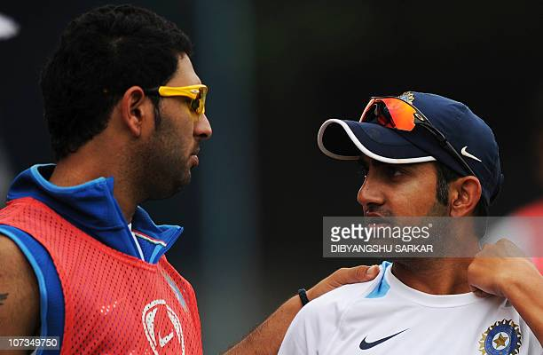 Indian cricketer Gautam Gambhir talks with Yuvraj Singh during a training session ahead of the fourth One Day International match between India and...