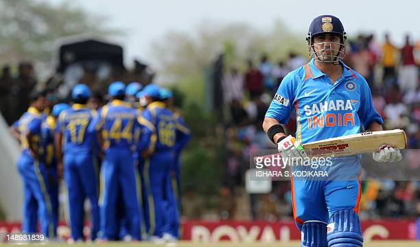 Indian cricketer Gautam Gambhir walks back to the pavilion after his dismissal during the opening oneday international match between Sri Lanka and...
