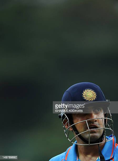 Indian cricketer Gautam Gambhir walks back to the pavilion after his dismissal during the fifth and final oneday international match between Sri...