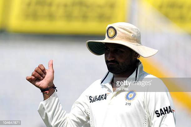 Indian cricketer Harbhajan Singh gestures towards the crowd during day two of the First Test match between India and Australia at Punjab Cricket...