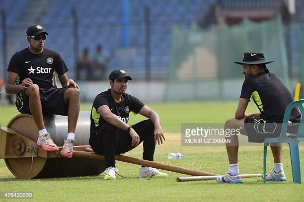 Indian cricketer Harbhajan Singh talk to his teammates Karn Sharma and Ravichandran Ashwin during a practice session at Khan Shaheb Osman Ali Stadium...