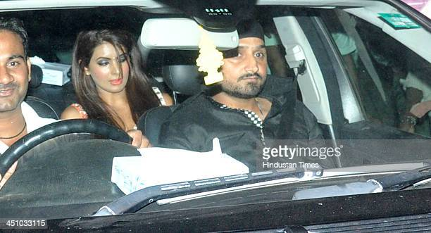 Indian Cricketer Harbhajan Singh with actor Geeta Basra arrive to attend the farewell party of Sachin Tendulkar at Waterstone Hotel Andheri on...