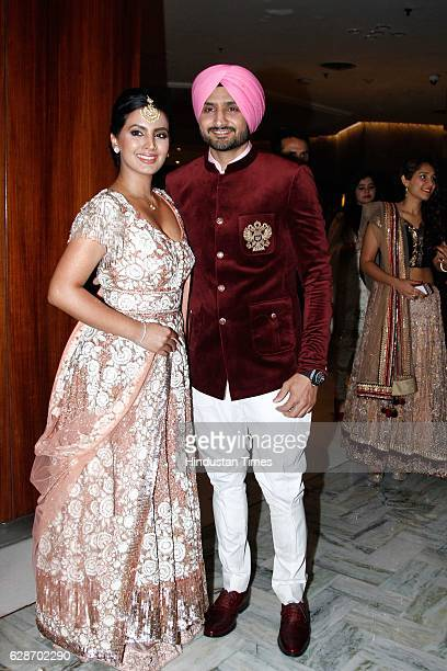 Indian Cricketer Harbhajan Singh with his wife and actor Geeta Basra during the wedding reception of Indian Cricketer Yuvraj Singh and Bollywood...
