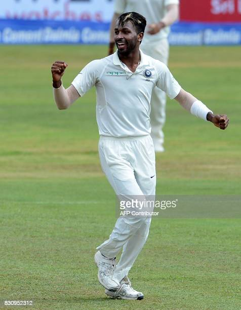 Indian cricketer Hardik Pandya celebrates after he dismissed Sri Lankan cricketer Angelo Mathews during the second day of the third and final Test...