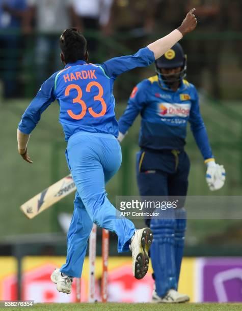Indian cricketer Hardik Pandya celebrates after he dismissed Sri Lanka's captain Upul Tharanga during the second one day international cricket match...