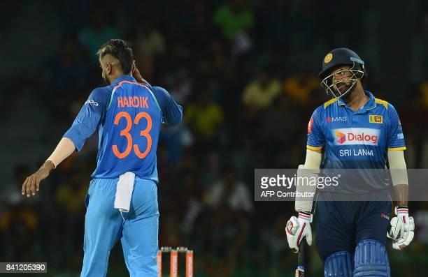 Indian cricketer Hardik Pandya celebrates after he dismissed Sri Lankan cricketer Lahiru Thirimanne during the fourth one day international cricket...