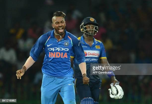 Indian cricketer Hardik Pandya celebrates after he dismissed Sri Lankan cricketer Milinda Siriwardana during the fourth one day international cricket...