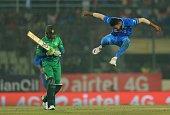 TOPSHOT Indian cricketer Hardik Pandya celebrates after the dismissal of the Pakistan cricketer Shoaib Malik during the match between India and...