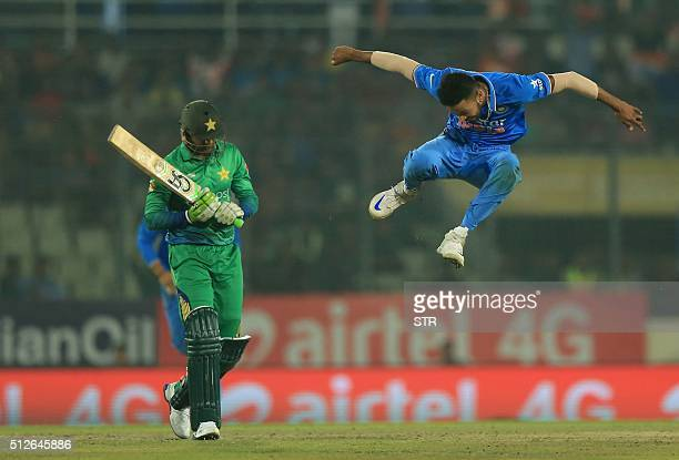 TOPSHOT Indian cricketer Hardik Pandya celebrates after the dismissal of the Pakistan cricketer Shoaib Malik during the match between India and...