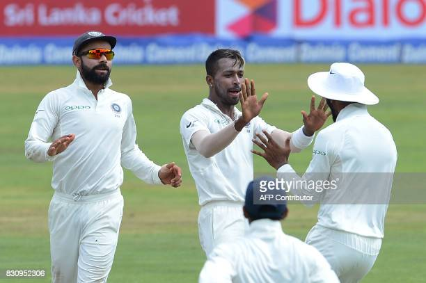 Indian cricketer Hardik Pandya celebrates with his teammates after he dismissed Sri Lankan cricketer Angelo Mathews during the second day of the...