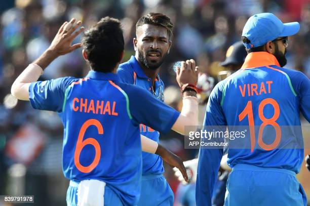 Indian cricketer Hardik Pandya celebrates with his teammates after he dismissed Sri Lankan cricketer Dinesh Chandimal during the third one day...