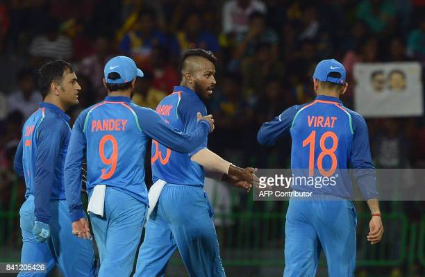 Indian cricketer Hardik Pandya celebrates with his teammates after he dismissed Sri Lankan cricketer Lahiru Thirimanne during the fourth one day...