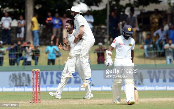 Indian cricketer Hardik Pandya celebrates with teammate Lokesh Rahul after dismissing Sri Lankan cricketer Niroshan Dickwella during the fourth day...