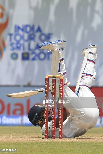 Indian cricketer Hardik Pandya loses his balance while batting during the 2nd Day's play in the 1st Test match between Sri Lanka and India at the...