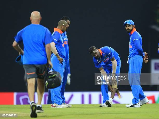 Indian cricketer Hardik Pandya suffers an injury in his leg during the 2nd One Day International cricket match between Sri Lanka and India at the...