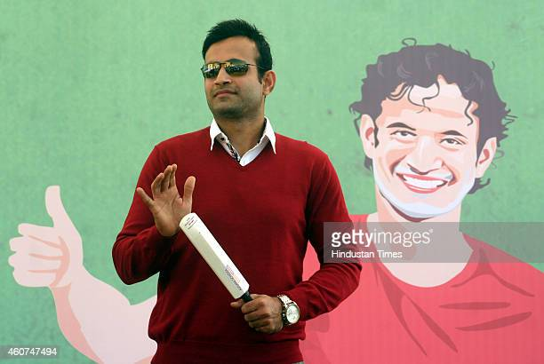 Indian cricketer Irfan Pathan addressing students during celebration of sports carnival at Asnani School on December 21 2014 in Bhopal India