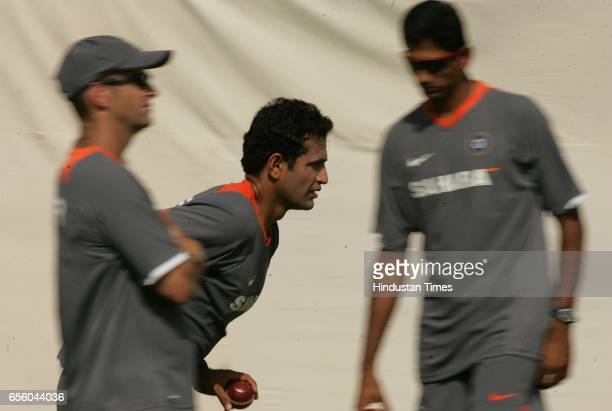 Indian cricketer Irfan Pathan bowls as coach Gary Kirsten and bowling coach Venkatesh Prasad watches during Indian cricketer net practice session...