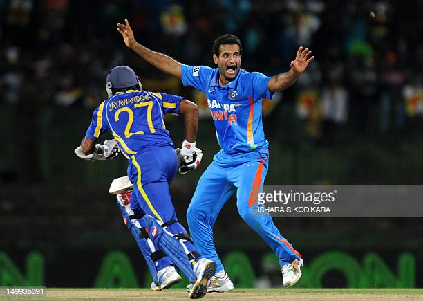 Indian cricketer Irfan Pathan celebrates after dismissing Sri Lankans Upul Tharanga during a Twenty20 match between Sri Lanka and India at the...