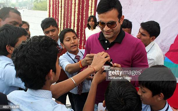 Indian Cricketer Irfan Pathan signing autographs while participating in a school function on December 20 2014 in Indore India