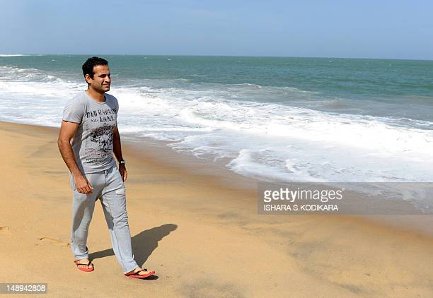 Indian cricketer Irfan Pathan walks along the beach in Hambantota on July 20 2012 India and Sri Lanka play the first of five oneday matches at...