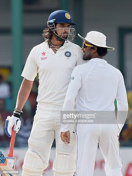 Indian cricketer Ishant Sharma and Sri Lankan cricketer Dinesh Chandimal exchange words during the fourth day of the third and final Test cricket...