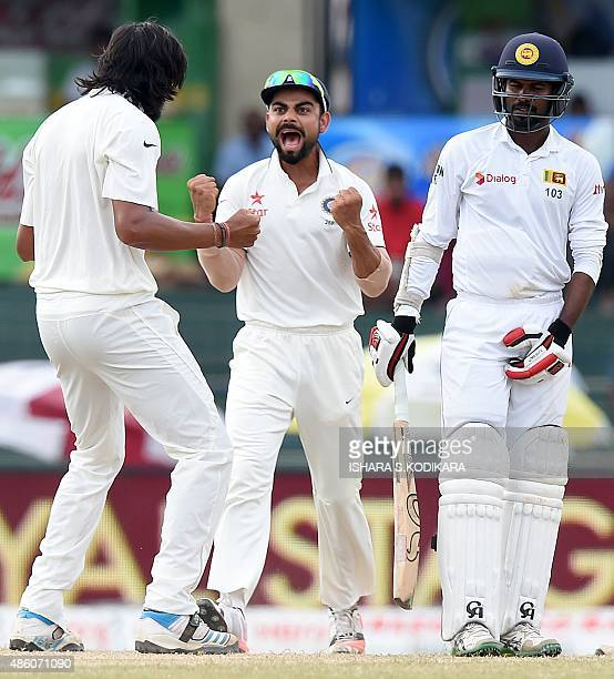 Indian cricketer Ishant Sharma and team captain Virat Kohli celebrate with teammates after dismissing Sri Lankan cricketer Upul Tharanga during the...