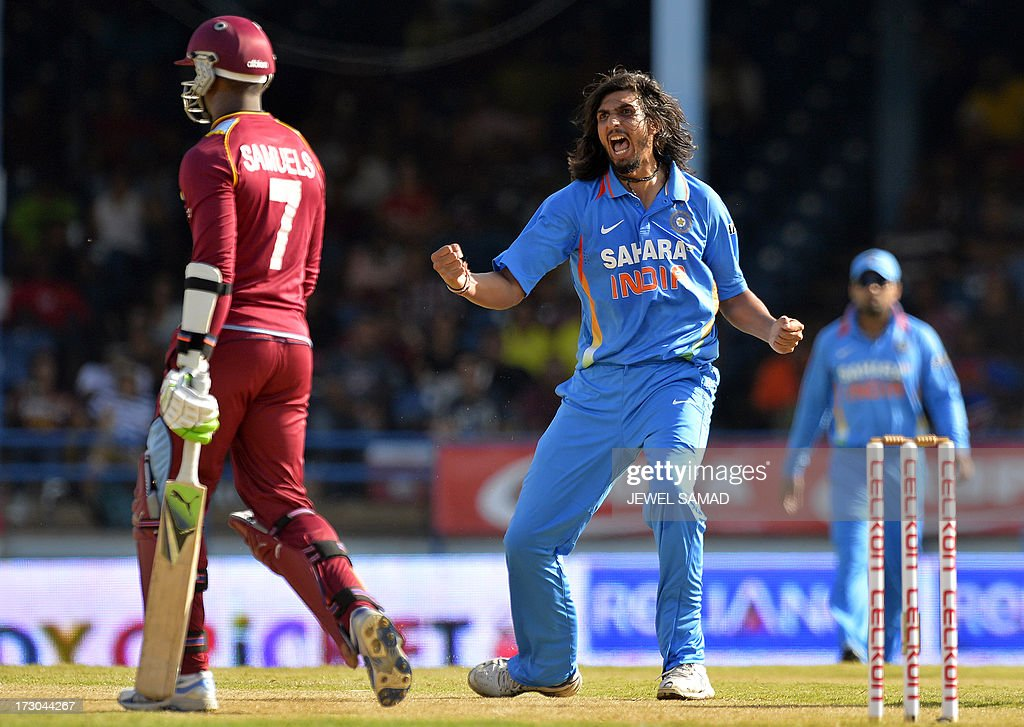 Indian cricketer Ishant Sharma (C) celebrates dismissing West Indies batsman Marlon Samuels during the fourth match of the Tri-Nation series between India and West Indies at the Queen's Park Oval in Port of Spain on July 5, 2013. India have scored 311/7 at the end of their innings. AFP PHOTO/Jewel Samad