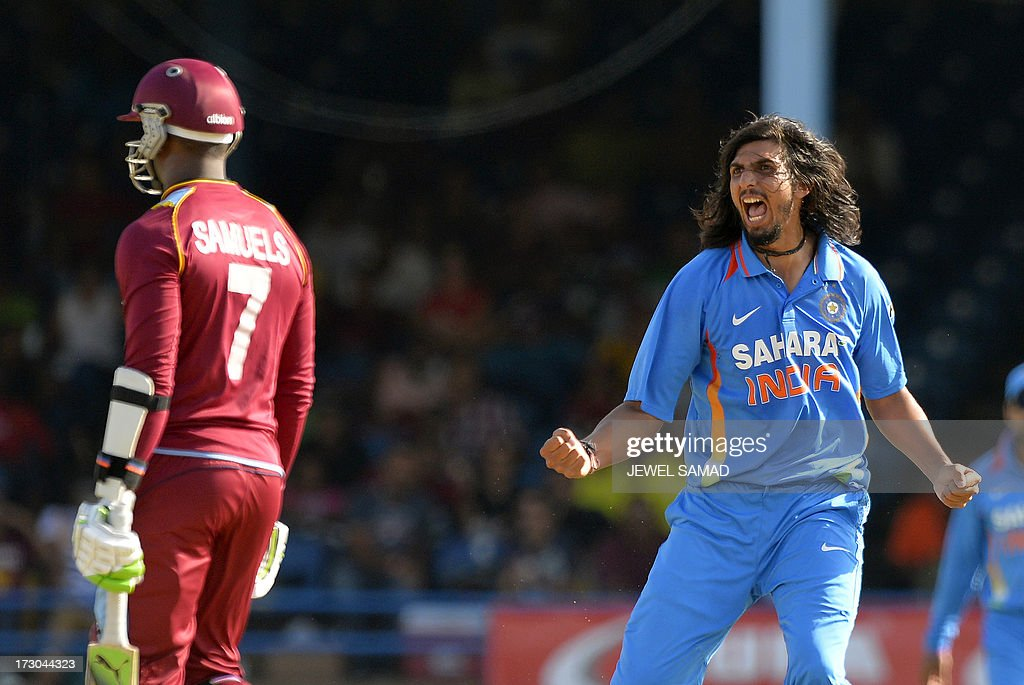 Indian cricketer Ishant Sharma (R) celebrates dismissing West Indies batsman Marlon Samuels (L) during the fourth match of the Tri-Nation series between India and West Indies at the Queen's Park Oval in Port of Spain on July 5, 2013. India have scored 311/7 at the end of their innings. AFP PHOTO/Jewel Samad