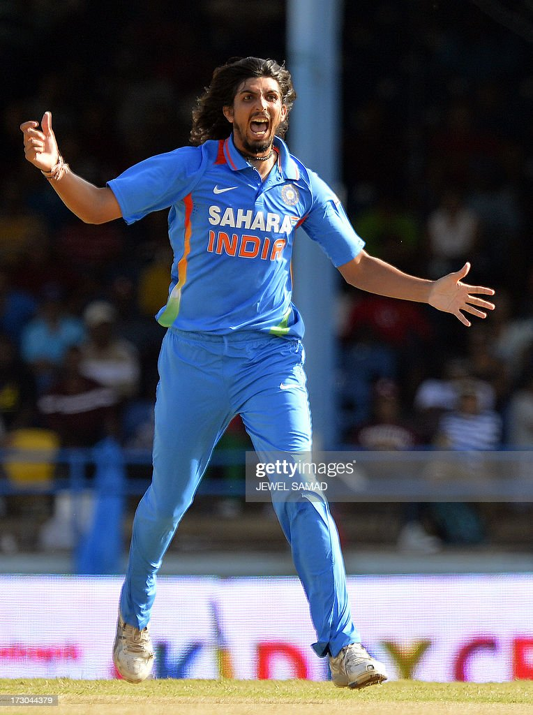 Indian cricketer Ishant Sharma celebrates dismissing West Indies batsman Marlon Samuels during the fourth match of the Tri-Nation series between India and West Indies at the Queen's Park Oval in Port of Spain on July 5, 2013. India have scored 311/7 at the end of their innings. AFP PHOTO/Jewel Samad