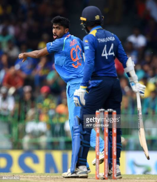 Indian cricketer Jasprit Bumrah celebrates after he dismissed Sri Lankan captain Upul Tharanga during the final one day international cricket match...