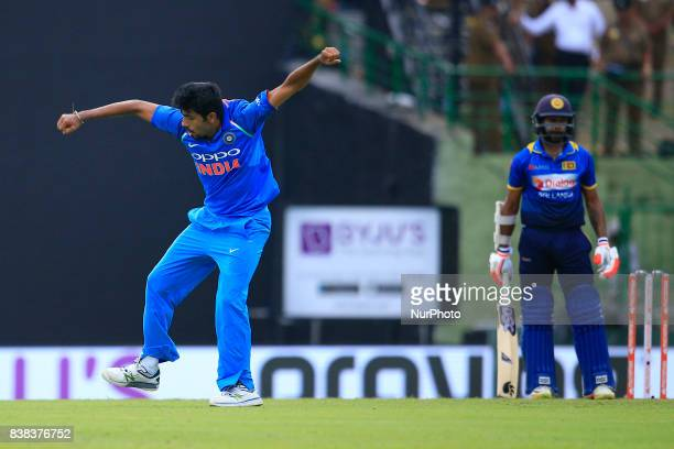 Indian cricketer Jasprit Bumrah celebrates after taking the wicket of Sri Lanka's Niroshan Dickwella during the 2nd One Day International cricket...