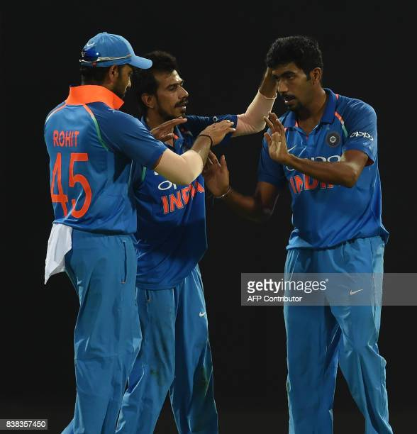 Indian cricketer Jasprit Bumrah celebrates with his teammates after he dismissed Sri Lankan cricketer Milinda Siriwardana during the second one day...