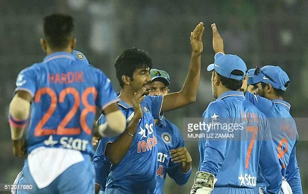 Indian cricketer Jasprit Bumrah celebrates with teammates after the dismissal of Bangladesh batsman Soumya Sarkar during a Twenty20 cricket match...