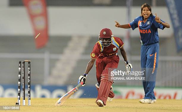 Indian cricketer Jhulan Goswami looks on as Kycia Knight of West Indies is run out during the inaugural match of the ICC Women's World Cup 2013...