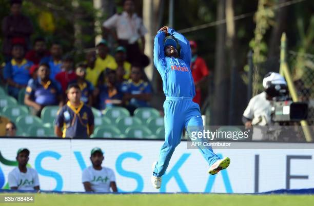 TOPSHOT Indian cricketer Kedar Jadhav takes a catch to dismiss Sri Lankan cricketer Wanindu Hasaranga during the first One Day International cricket...