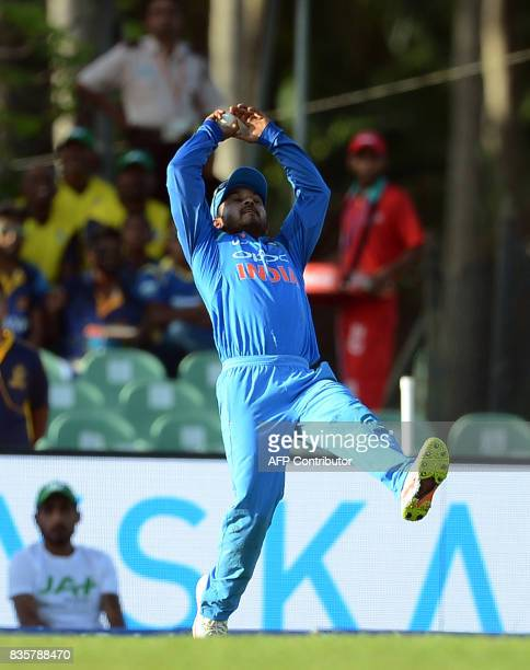 Indian cricketer Kedar Jadhav takes a catch to dismiss Sri Lankan cricketer Wanindu Hasaranga during the first One Day International cricket match...