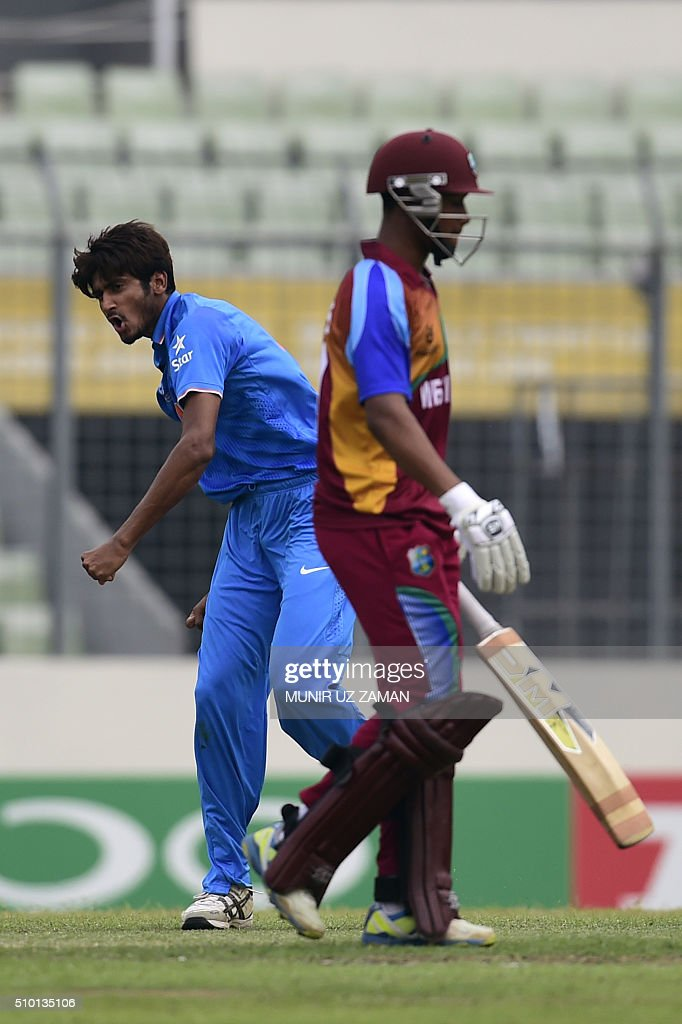 Indian cricketer Khaleel Ahmed (L) reacts after the dismissal of the West Indies cricketer Tevin Imlach (R) during the under-19s World Cup cricket final between India and West Indies at the Sher-e-Bangla National Cricket Stadium in Dhaka on February 14, 2016. AFP PHOTO/Munir uz ZAMAN / AFP / MUNIR UZ ZAMAN
