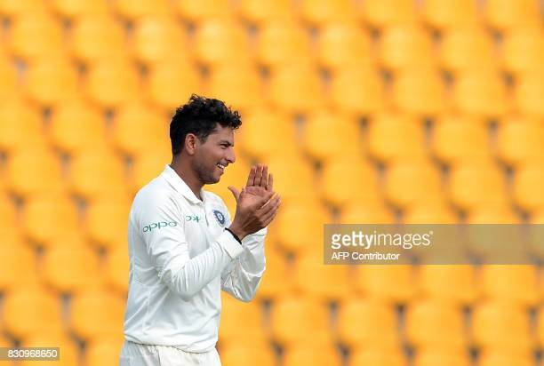 Indian cricketer Kuldeep Yadav celebrates after he dismissed Sri Lankan cricketer Dilruwan Perera during the second day of the third and final Test...