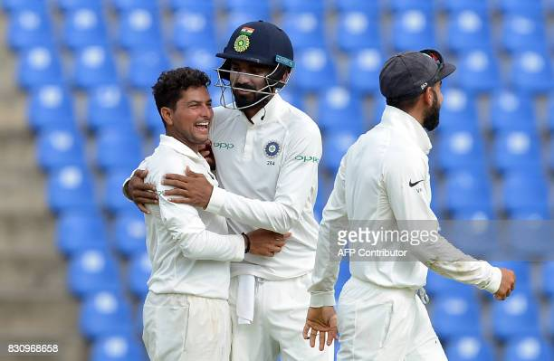 Indian cricketer Kuldeep Yadav celebrates with his teammates after he dismissed Sri Lankan cricketer Dilruwan Perera during the second day of the...