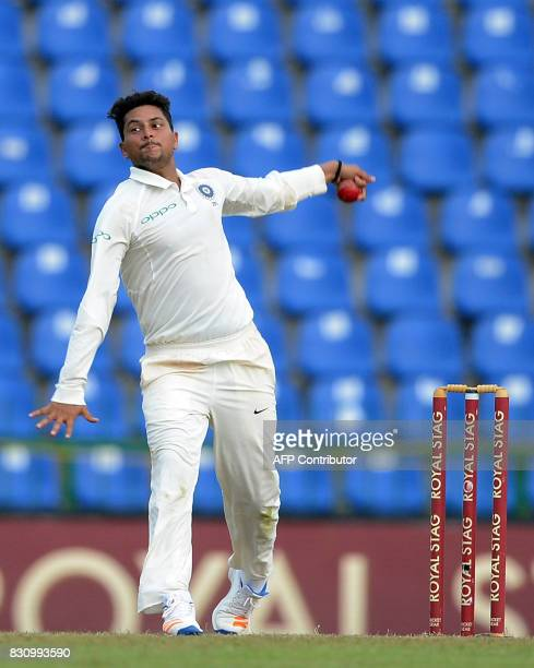 Indian cricketer Kuldeep Yadav delivers the ball during the second day of the third and final Test match between Sri Lanka and India at the Pallekele...