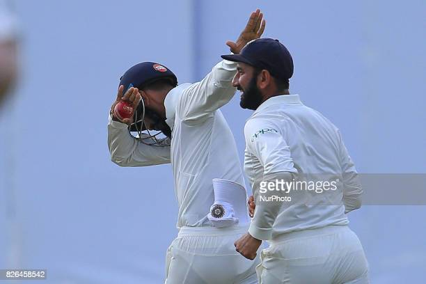 Indian cricketer Lokesh Rahul celebrates after Sri Lankan cricketer Upul Tharanga was dismissed during the 2nd Day's play in the 2nd Test match...