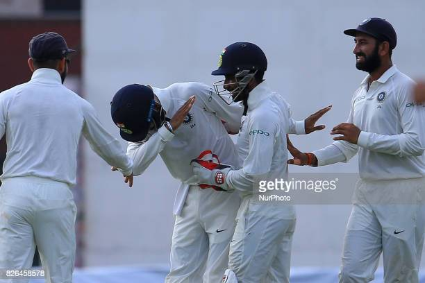 Indian cricketer Lokesh Rahul celebrates with his team mates after he held on to a catch to dismiss Sri Lanka's Upul Tharanga during the 2nd Day's...